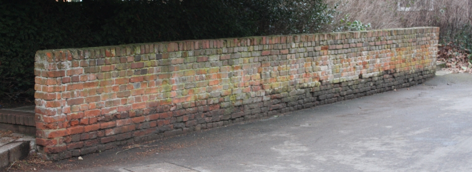 The only surviving wall of the fives court. This particular court was reserved for the use of prefects, consequently all other boys were forbidden to cross the court, so had to walk behind the wall. This tradition survived at least until the 1940s even though the court and wall had long lost their original purpose.